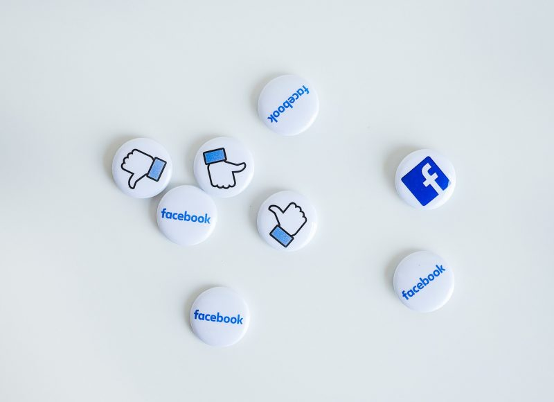 Facebook logo and thumbs up buttons